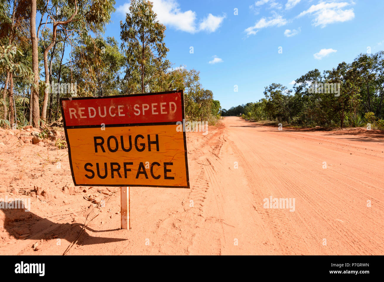 Road sign warning of rough surface on the remote Peninsula Development Road (PDR), Cape York, Far North Queensland, FNQ, QLD, Australia - Stock Image
