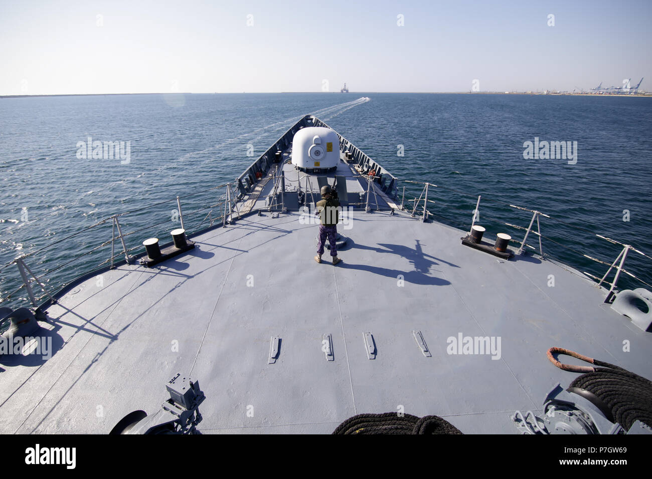 CONSTANTA, ROMANIA - JUNE 20, 2018: Romanian military sailor on deck of 'Regele Ferdinand' frigate mans a 50 caliber machine gun, on June 20. - Stock Image