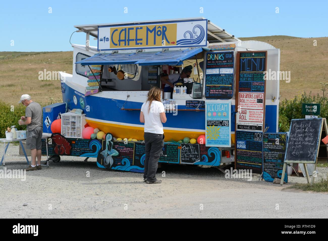 Solar powered food van shaped like a boat Cafe Mor Freshwater West Pembrokeshire Wales Cymru UK - Stock Image