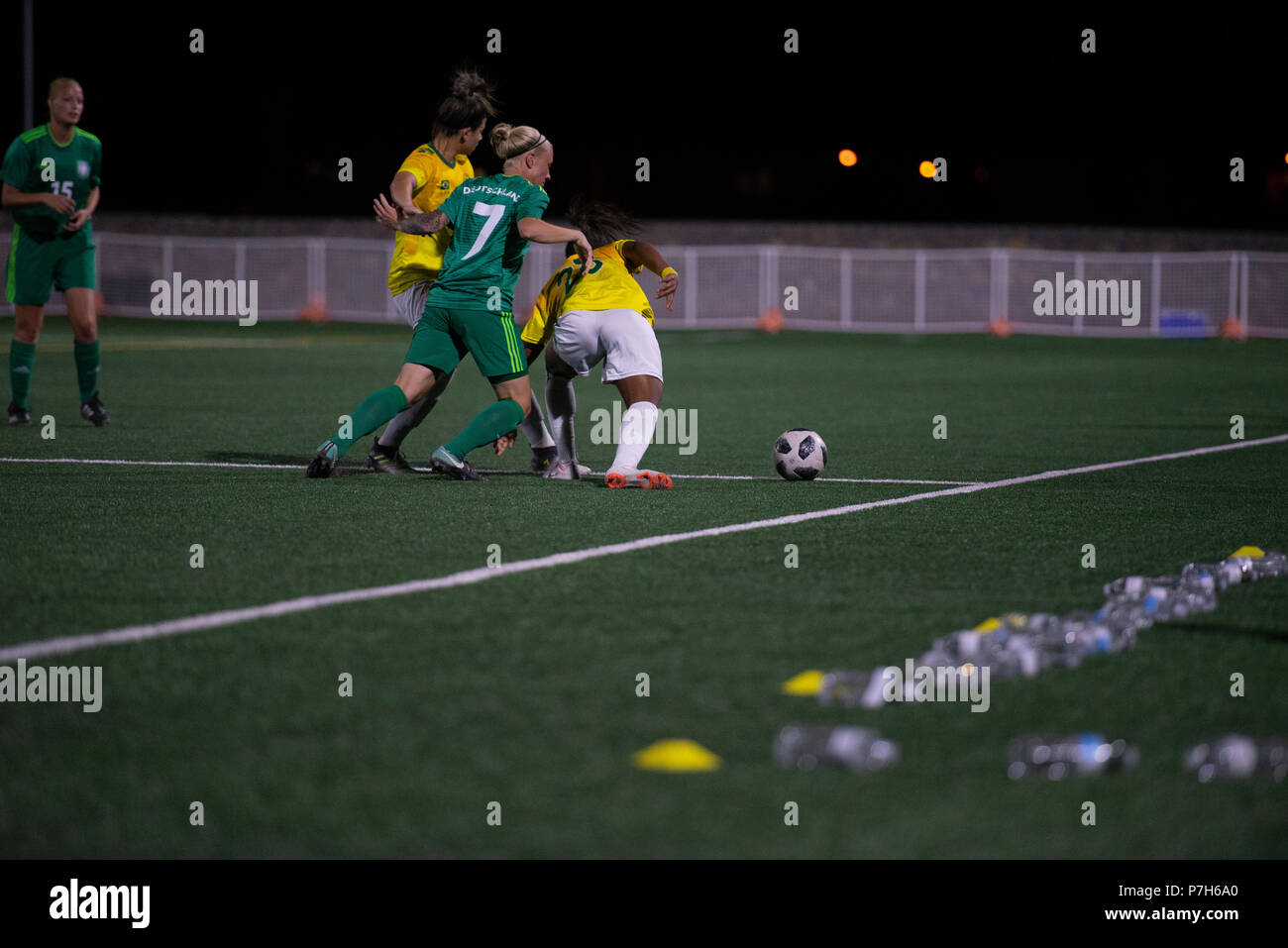 FORT BLISS, Texas - German and Brazilian players battle for ball possession along the edge of the field during the final official match of the 2018 Conseil International du Sport Militaire (CISM) World Military Women's Football Championship. International military teams squared off to eventually crown the best women soccer players among the international  militaries participating. U.S. Navy photo by Mass Communication Specialist 3rd Class Camille Miller (Released) - Stock Image