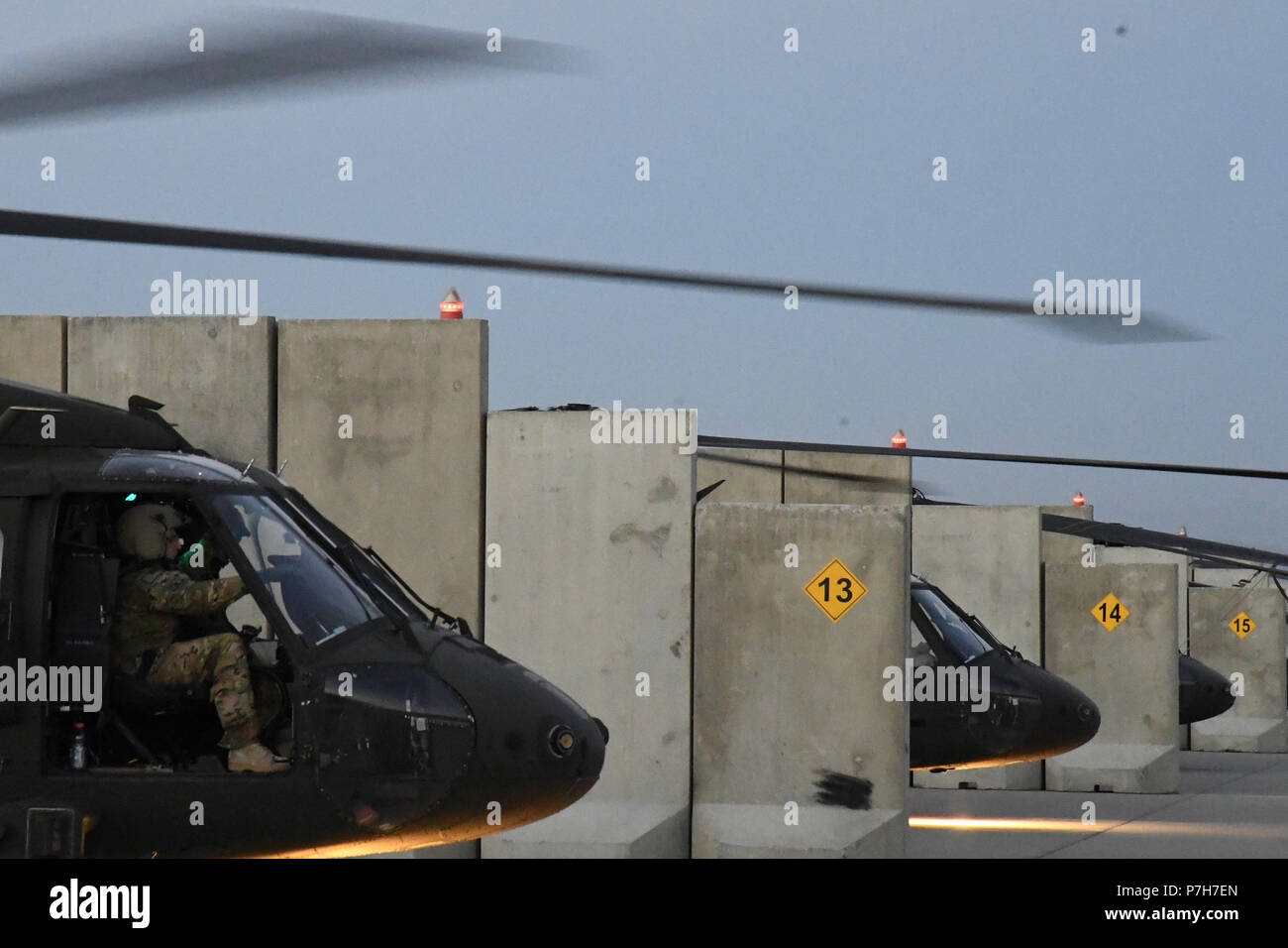 A UH-60 Blackhawk helicopter assigned to Task Force Shadow conducts a pre flight run-up and health indicator test to validate engine performance at Bagram Airfield, July 2. - Stock Image
