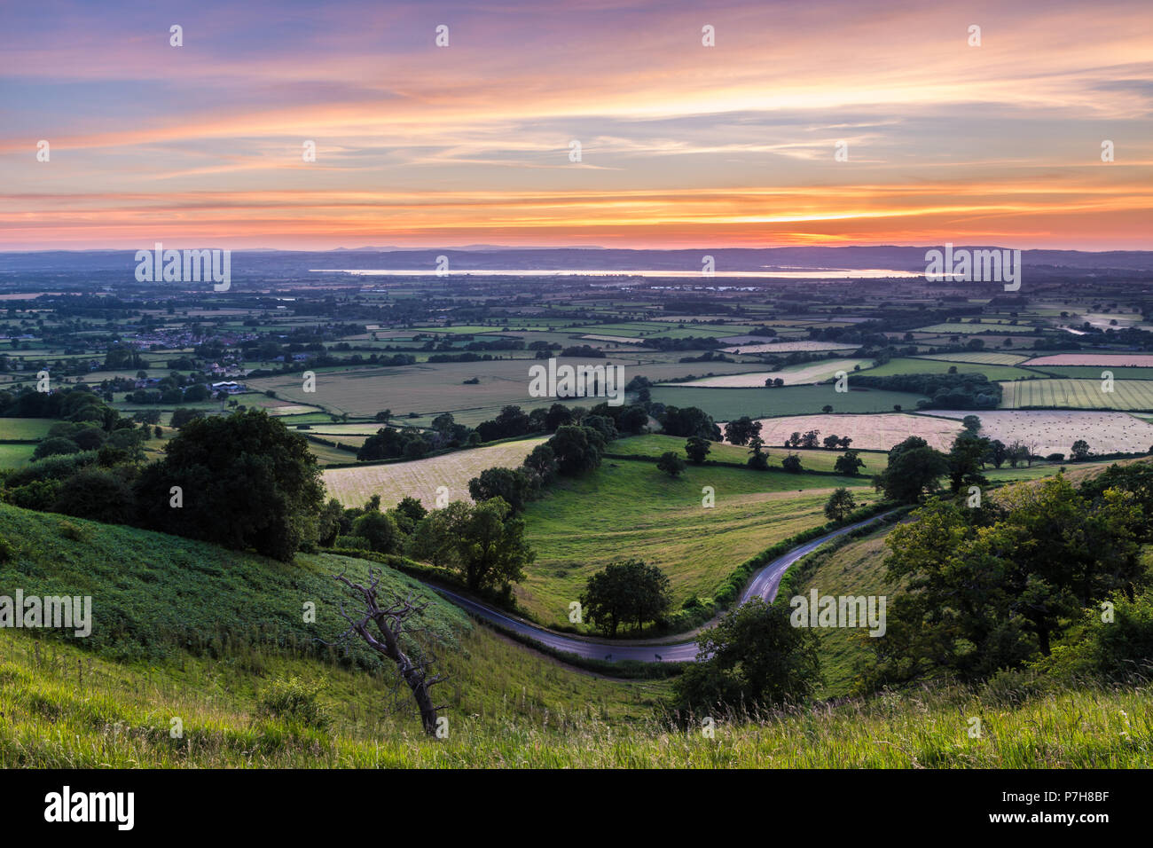 Sunset view across the Severn valley from Coaley Peak - Stock Image