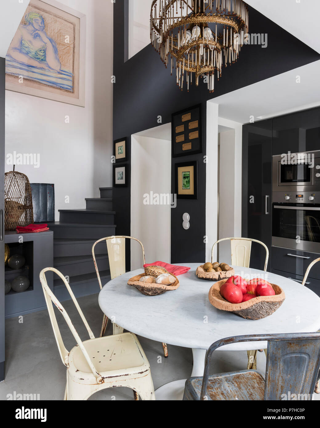 Dining area in modern open plan apartment with vintage metal ...