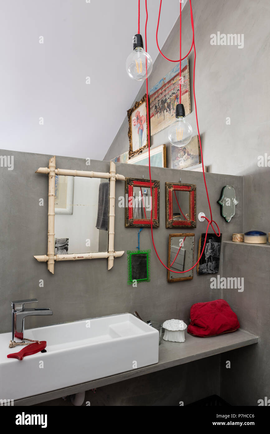 A selection of small vintage mirrors in bathroom of loft ...