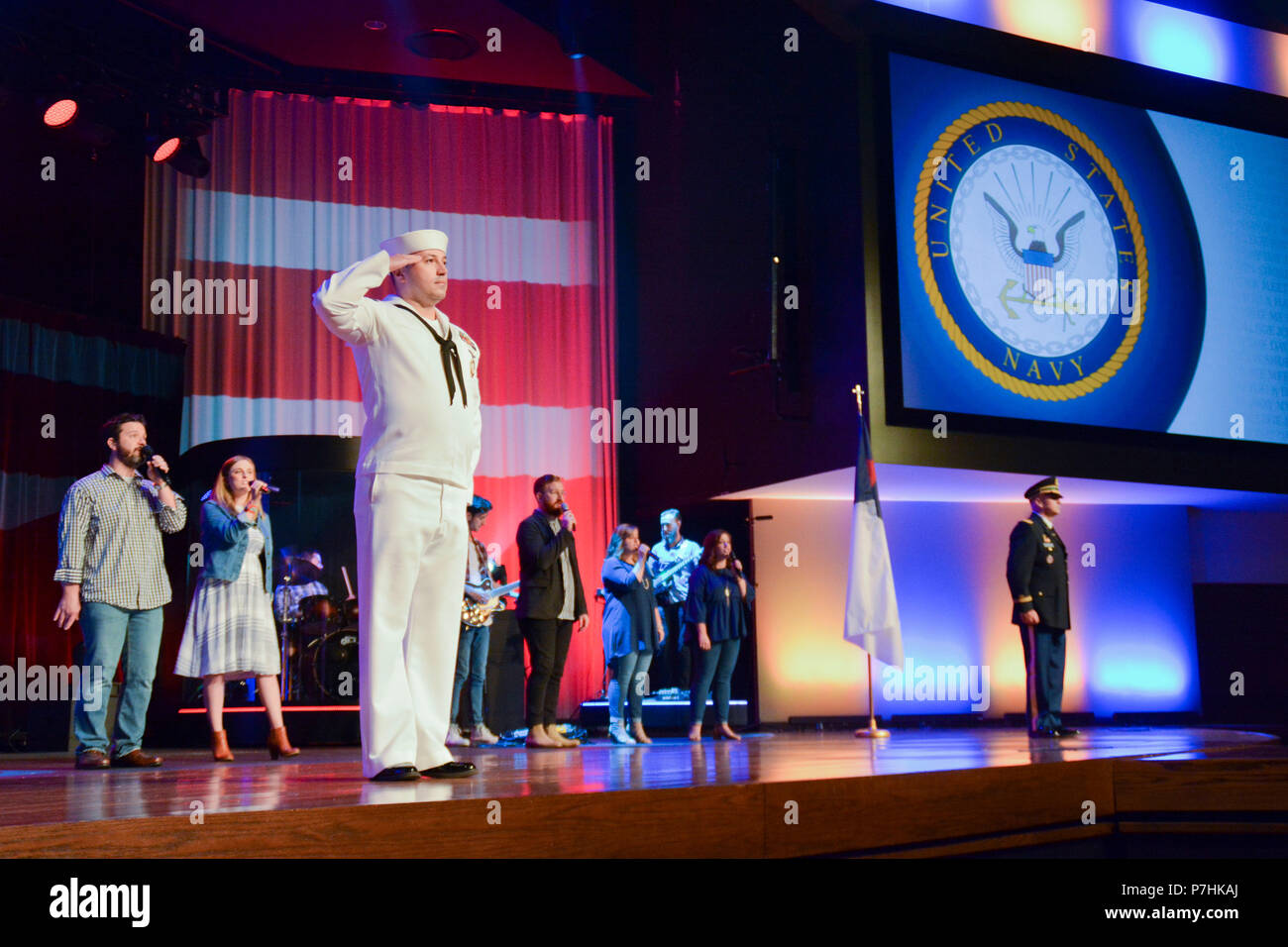 180701-N-CO784-020 PROSPER, Texas (July 01, 2018)  Damage Controlman 1st Class Sergiu Cretu,     attached to Navy Recruiting District Dallas, epresents the Navy during a Military Appreciation church service at Prestonwood Baptist Church.  Members from each branch of service was honored at the service.  Each branch of the Armed Forces  was represented with their respected service song. (U.S. Navy photo by MCSN Nolan Pennington/Released) - Stock Image