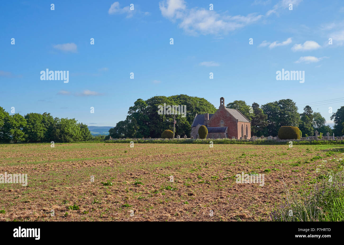 Stracathro Parish Church in the Mearns valley close to an Old Roman Camp amongst arable farmland with the Angus Glens in the distance, Angus, Scotland - Stock Image