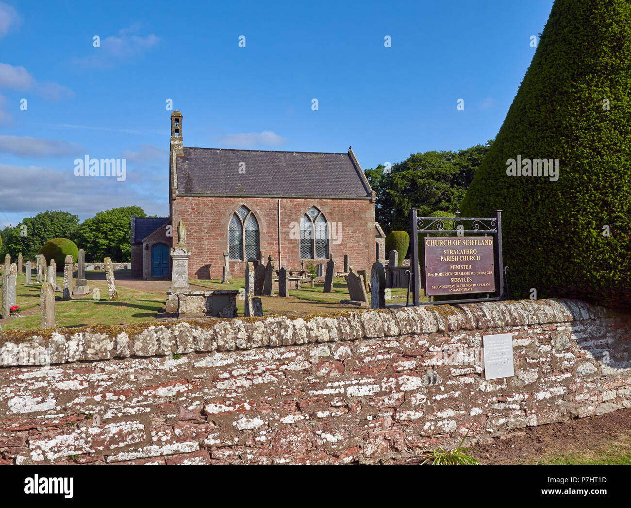 Side view of Stracathro Parish Church and its Noticeboard with its well kept Graveyard and environs, Stracathro, Angus, Scotland. - Stock Image