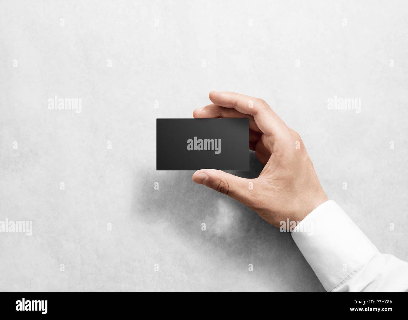 Hand hold blank plain black business card design mockup clear hand hold blank plain black business card design mockup clear namecard mock up template holding arm visit pasteboard paper surface display front ch reheart Choice Image