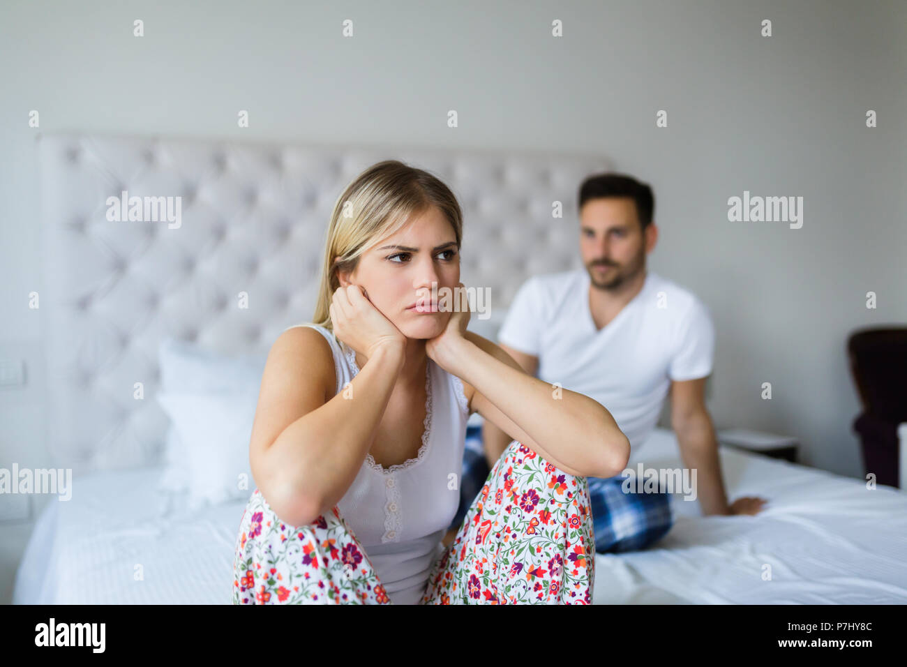 Young unhappy couple having problems in relationship - Stock Image