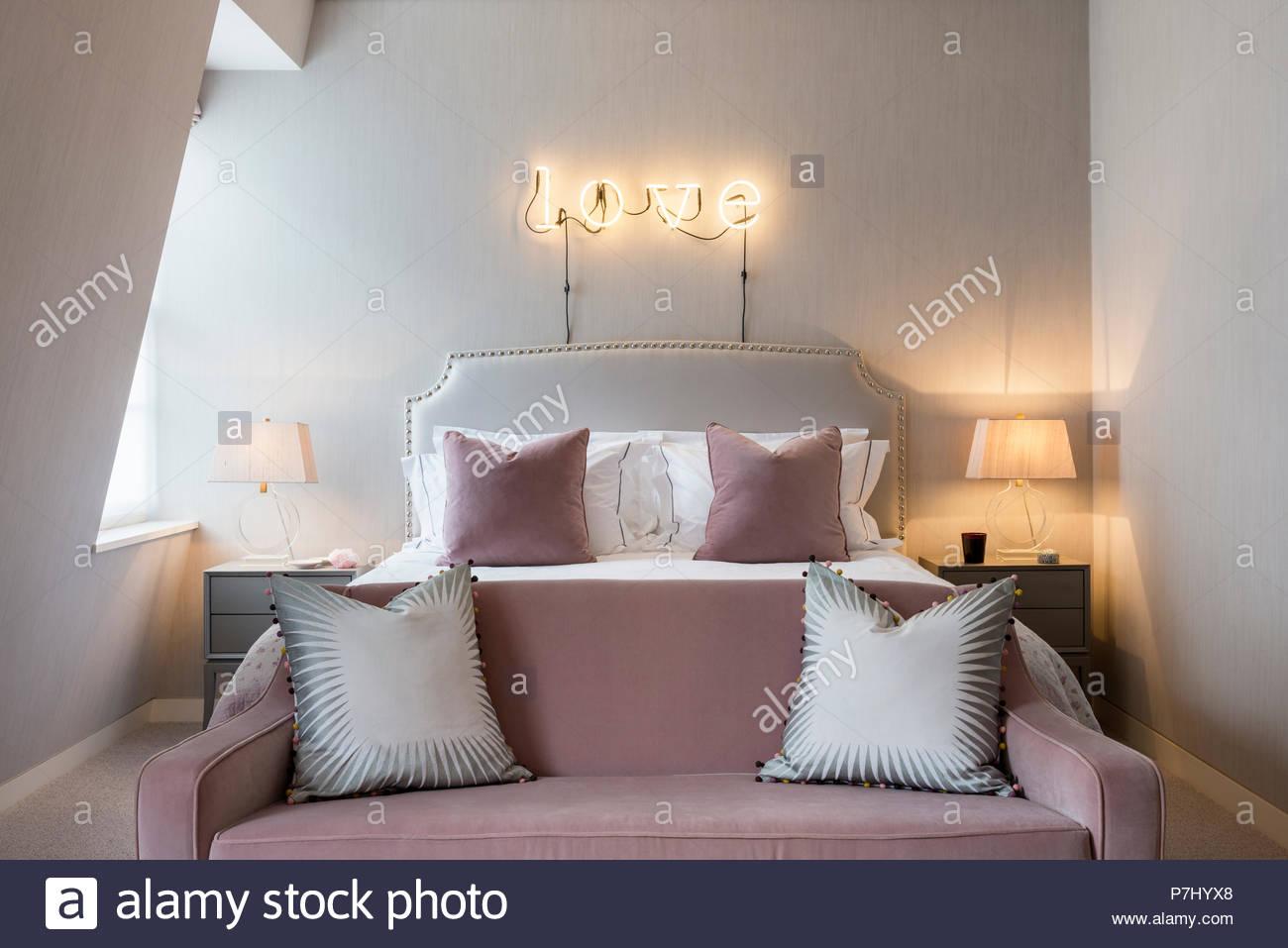 Neon Sign Above Bed In Feminine Bedroom
