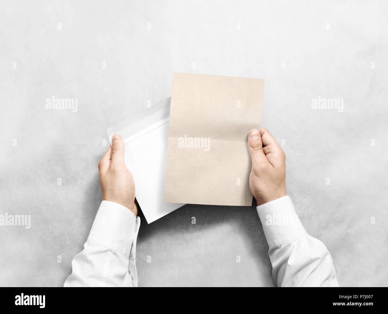 hand holding blank envelope and kraft letter mockup isolated arm