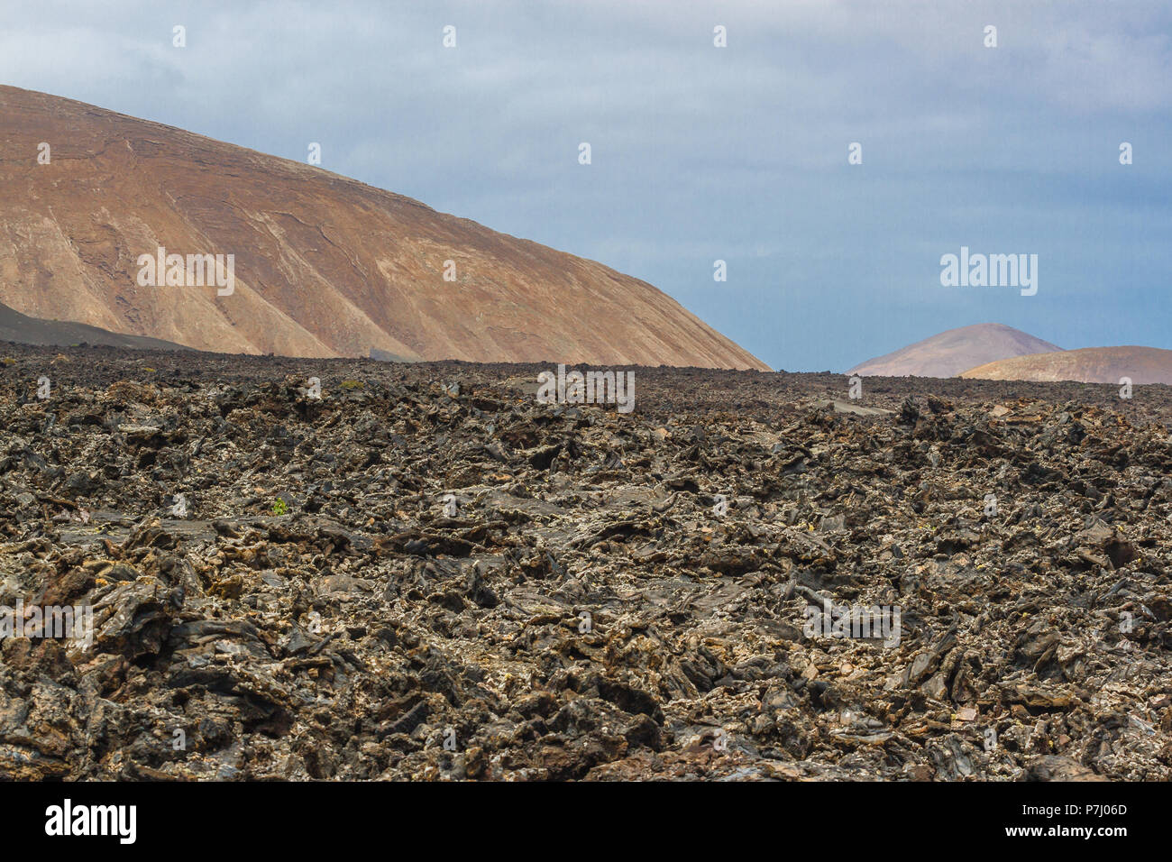 Volcanic rock from lava flow. Lava field in Timanfaya National Park in Lanzarote, Canary Islands, Spain. - Stock Image