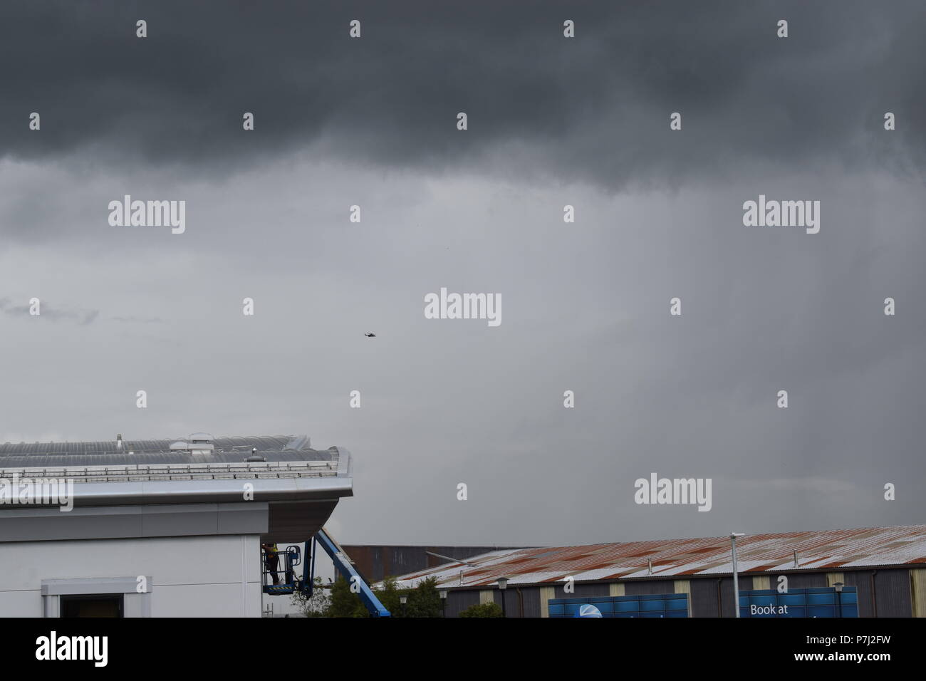 Rainy day at Aberdeen Airport with Helicopter in the distance - Stock Image