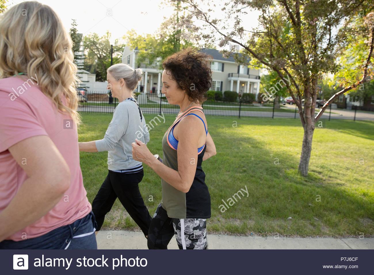 Senior women walking, exercising in park - Stock Image
