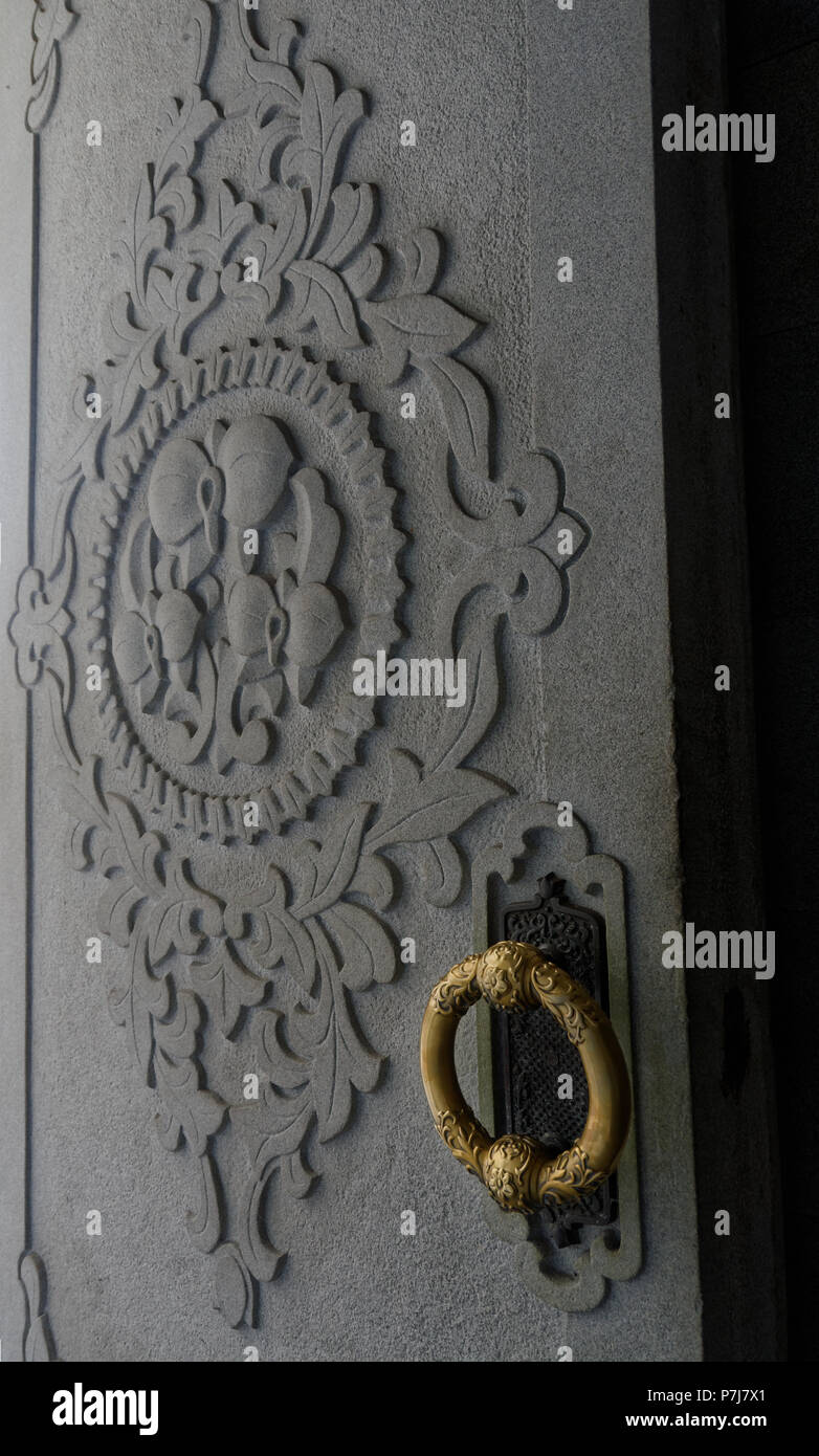 Brass ring and seal on one of the doors that lock at the entry to the Juche Tower, Pyongyang, North Korea - Stock Image