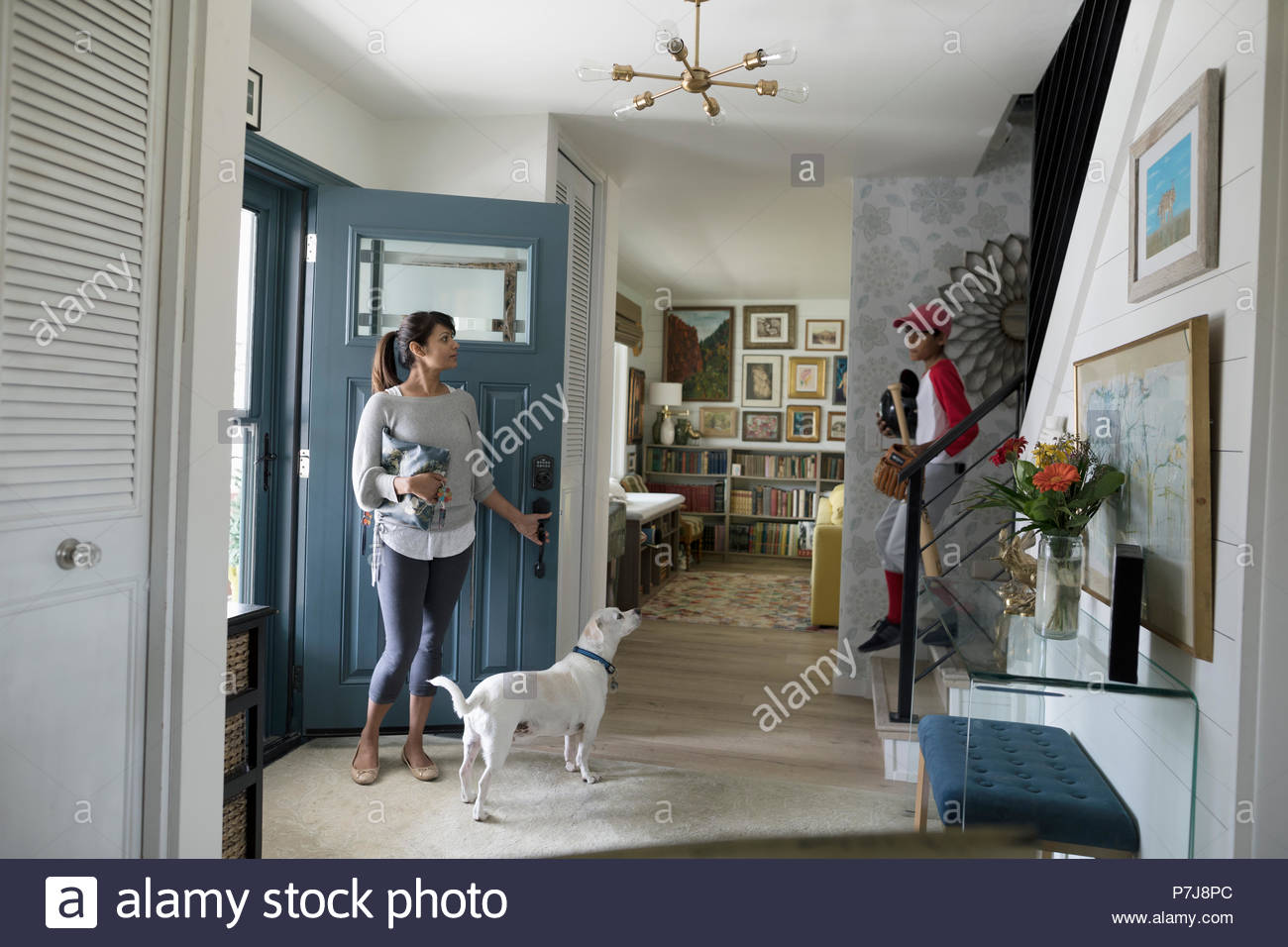 Woman and dog waiting in foyer - Stock Image