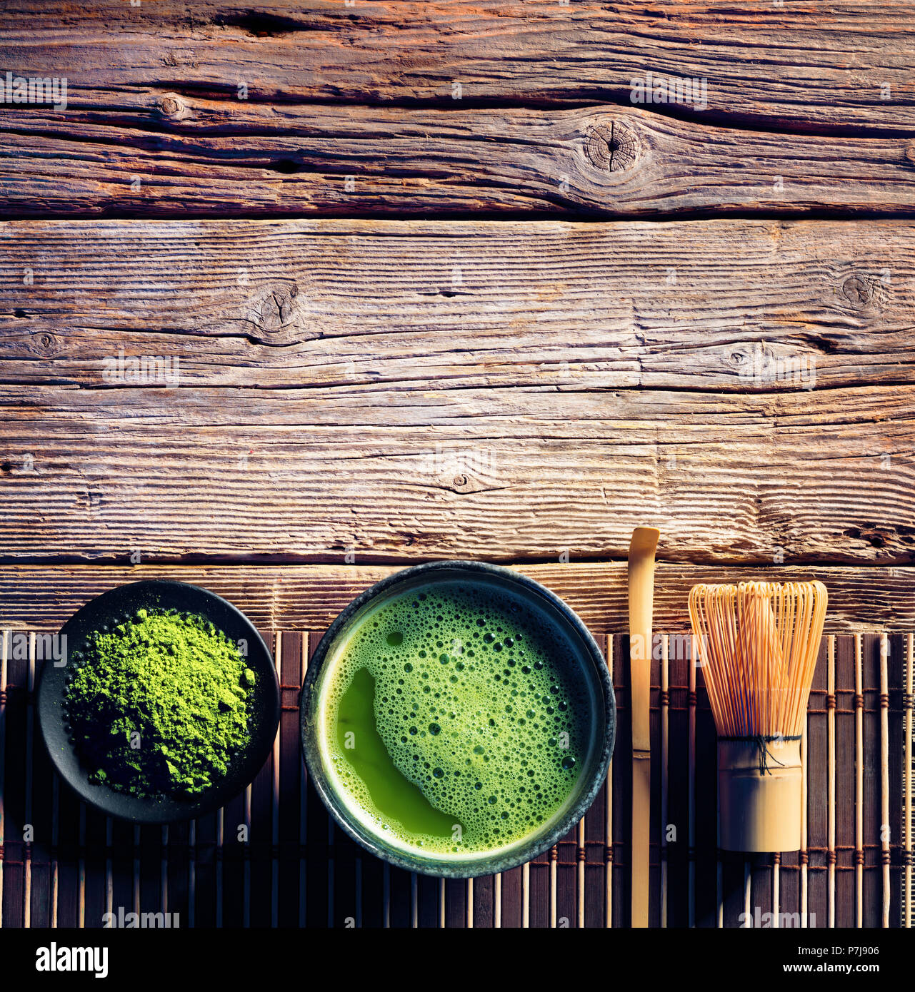 Matcha Tea In A Bowl And Bamboo Whisk And Green Powder - Stock Image