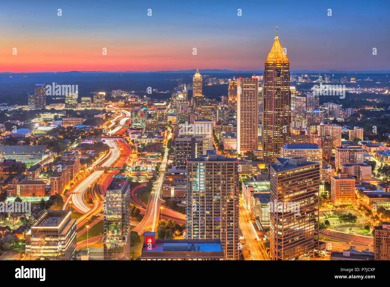 Atlanta, Georgia, USA downtown skyline over the highways at dusk. - Stock Image