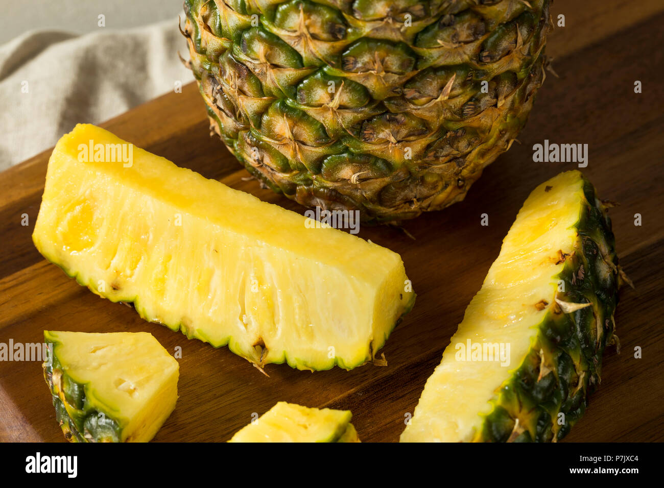 Raw Yellow Organic Pineapple Slices Ready to Eat - Stock Image
