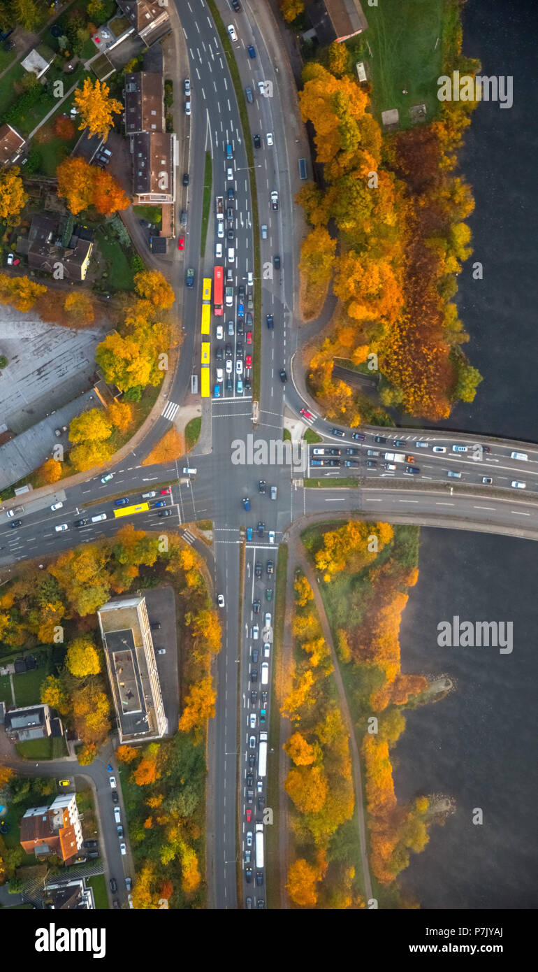 Marie-Jucharcz-Strasse and Konrad-Adenauer-Brücke, crossing at the Zornige Ameise, road intersection, yellow buses of the EVAG, autumn leaves, autumn mood, morning mood, Essen, Ruhrgebiet, North Rhine-Westphalia, Germany - Stock Image