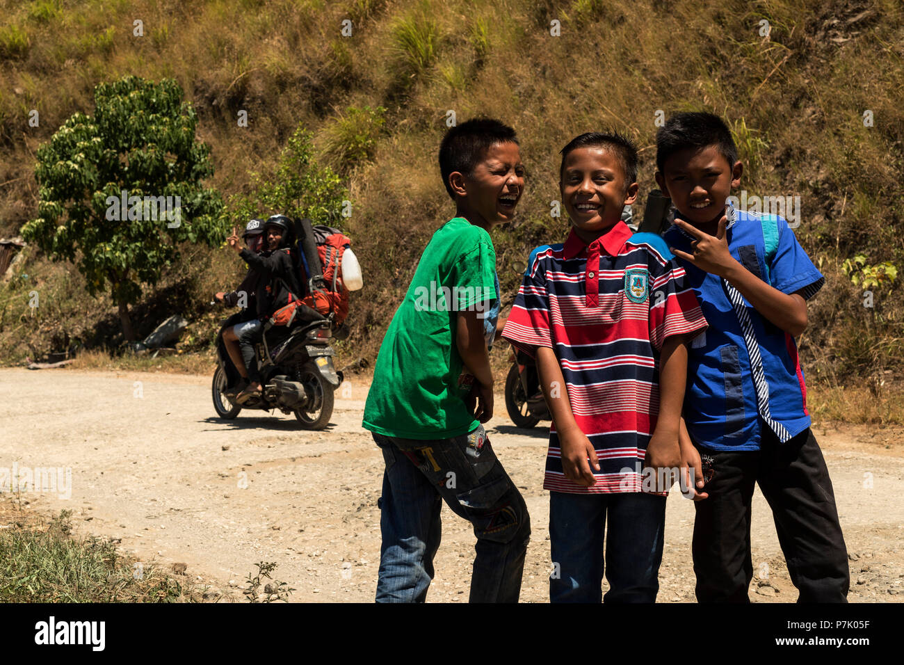 Three boys having fun being photographed - Stock Image