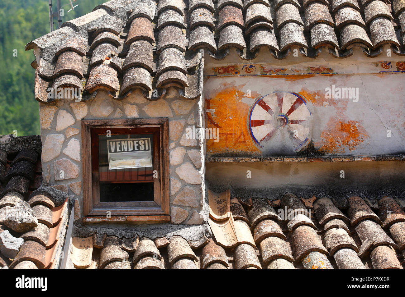 Roof detail of a house for sale in Italy. - Stock Image