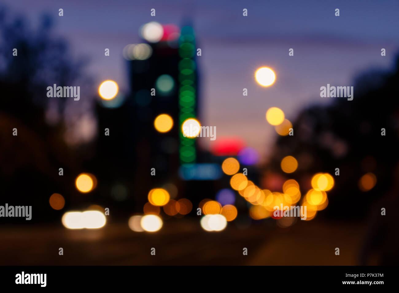 Blurred night city life, road traffic, illuminate. Sunset background. - Stock Image