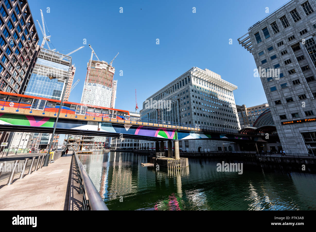 London, UK - June 26, 2018: Cityscape skyline of Canary Wharf Docklands dock construction modern skyscrapers architecture during sunny summer in morni Stock Photo