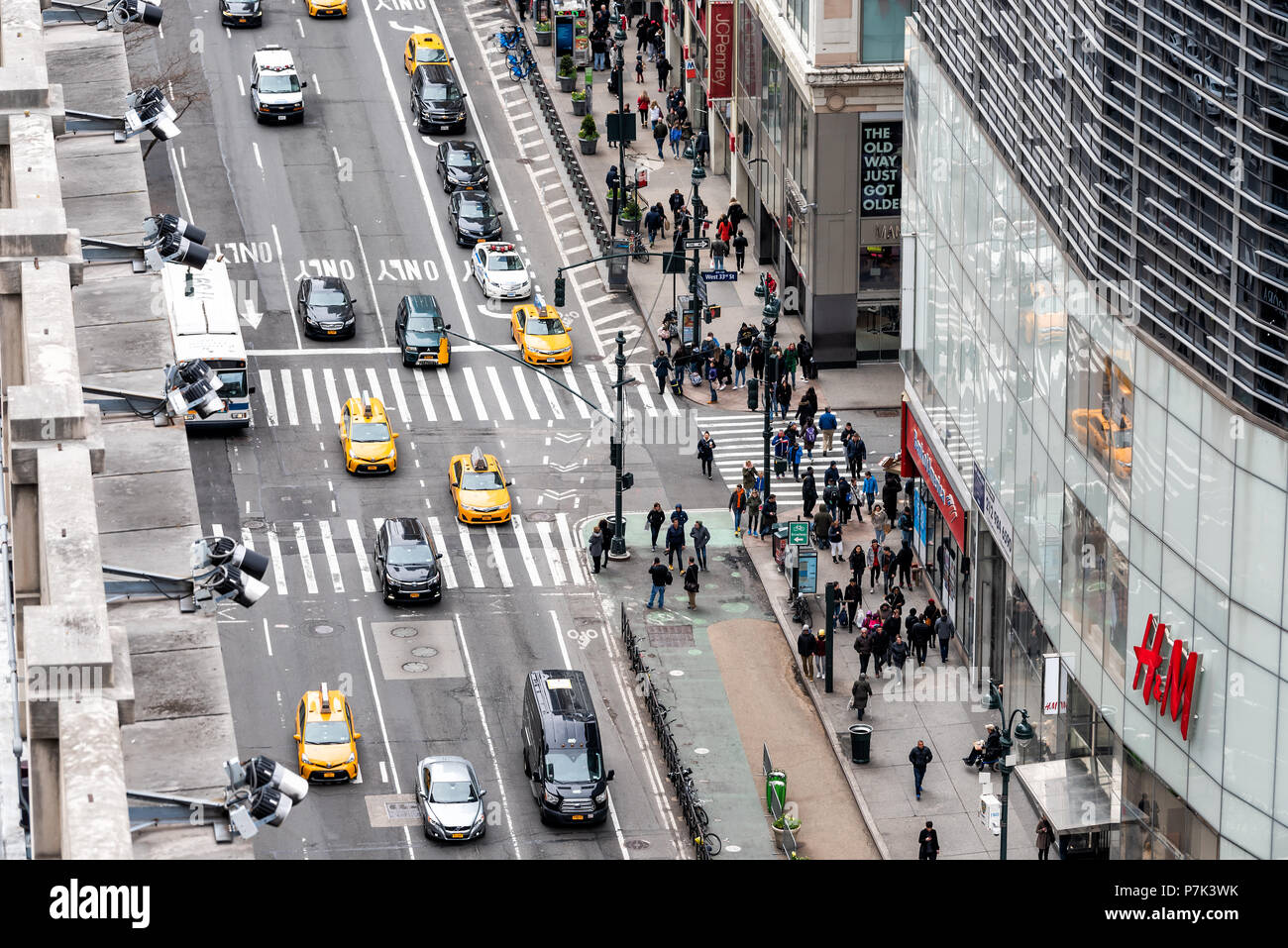 New York City, USA - April 7, 2018: Aerial view of urban building in NYC Herald Square Midtown with security cameras on road 6th avenue street, HM Stock Photo