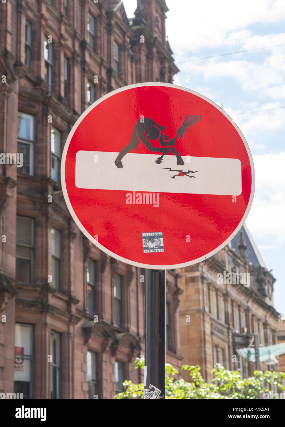 "Clet Abraham street art road sign title ""The Clash""  on Buchanan Street, Glasgow, Scotland, UK Stock Photo"