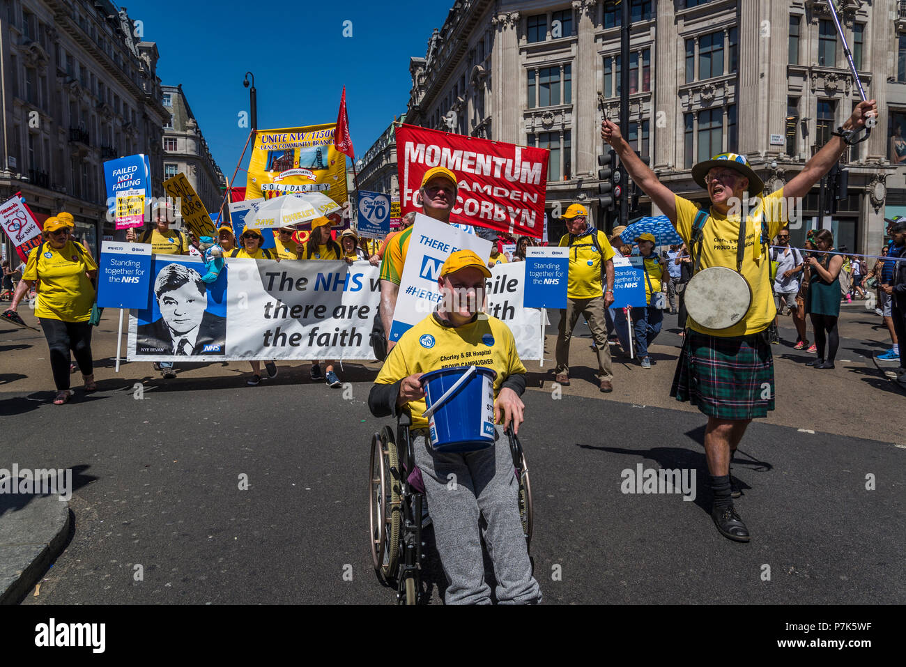 NHS 70th Anniversary March organised by People's Assembly, Person in wheelchair and Nye Bevan banner, London, UK, 30/06/2018 - Stock Image