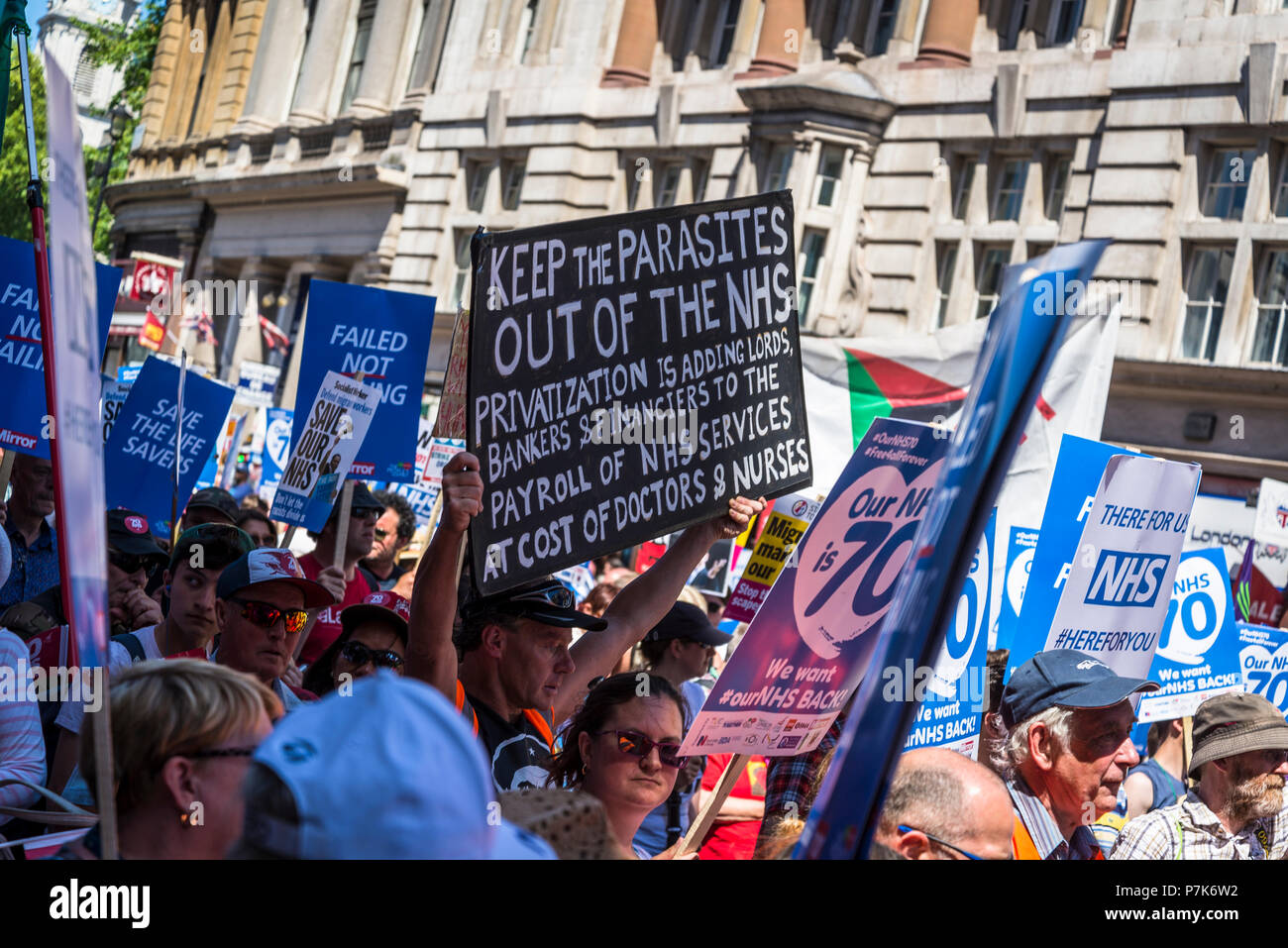 NHS 70th Anniversary March organised by People's Assembly, Poster agains privatisation of health, London, UK, 30/06/2018 - Stock Image