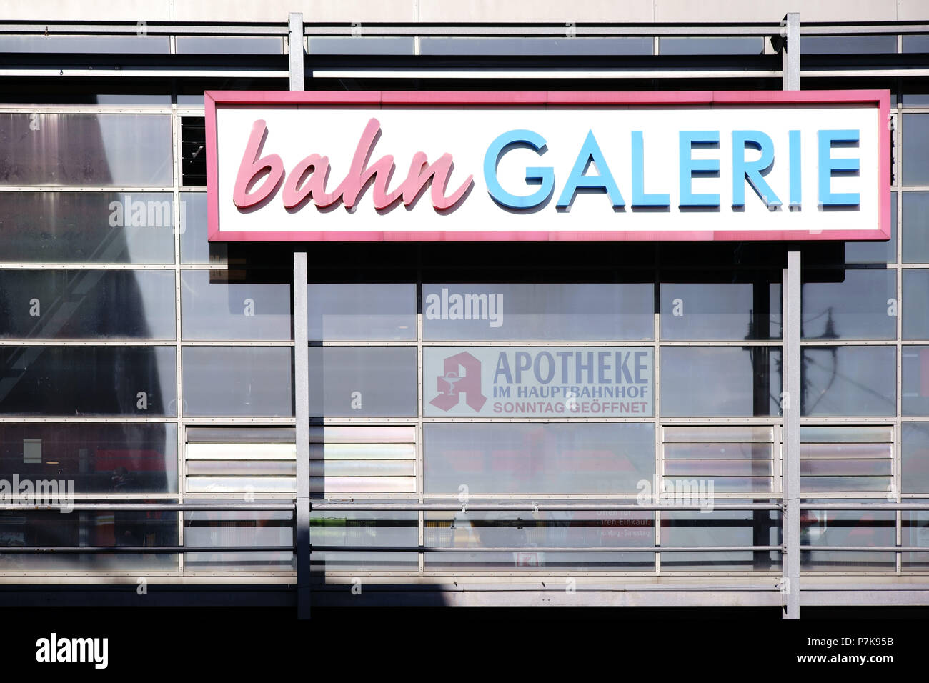 Sign and logo of 'bahn Galerie' on a glass facade of the Darmstadt central station, - Stock Image