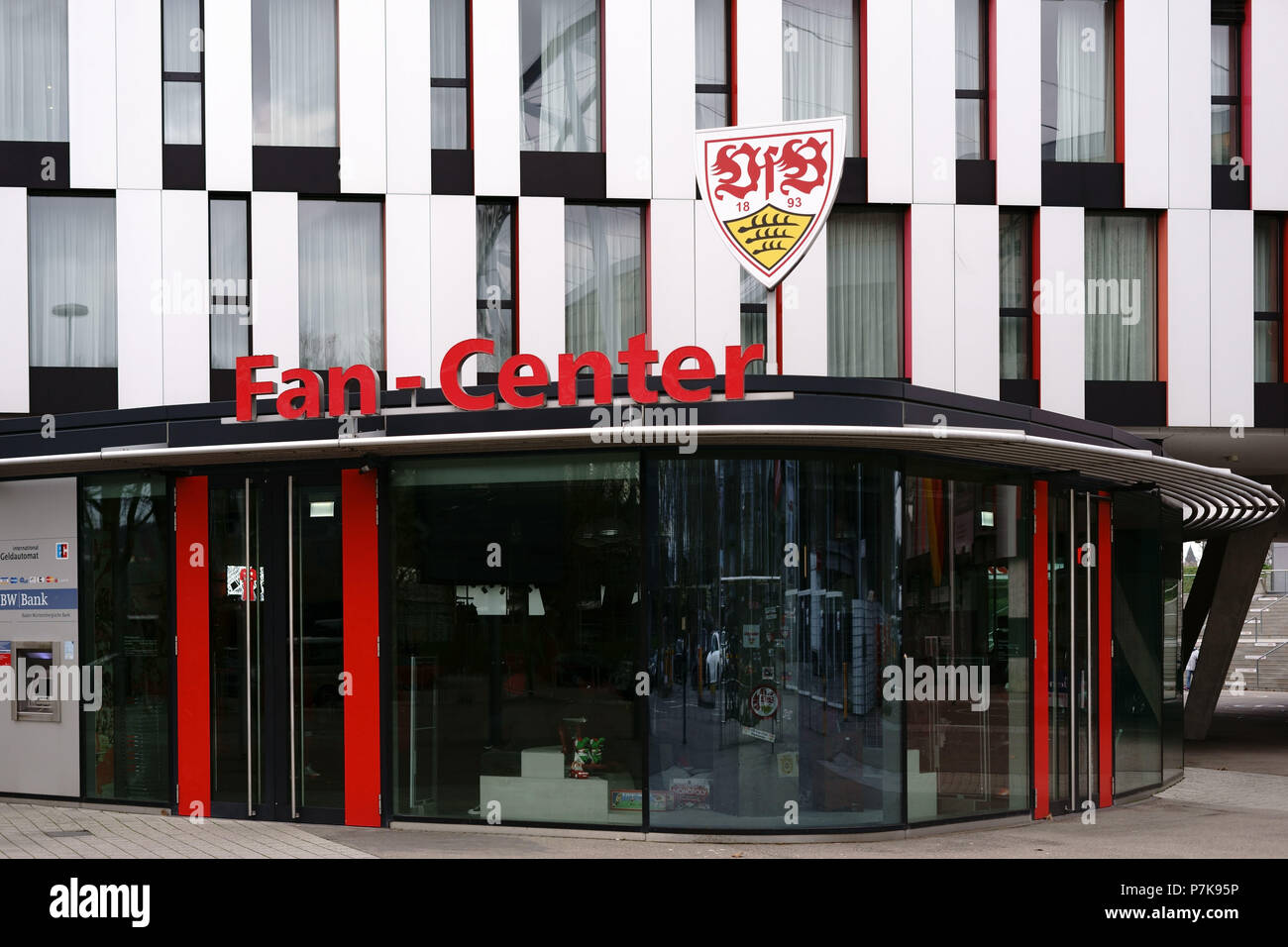 The showcase of the fan center of the VFB Stuttgart at the Mercedes-Benz Arena with the club logo above the entrance, - Stock Image