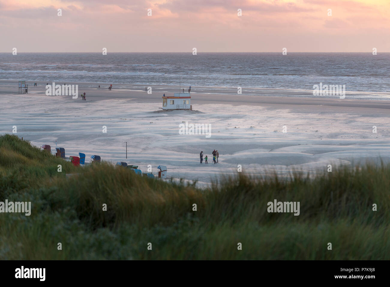 Germany, Lower Saxony, East Frisia, Juist, Blue hour on the beach. - Stock Image