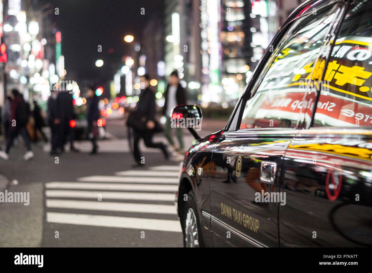 A taxi at Tokyo's nightlife - Stock Image