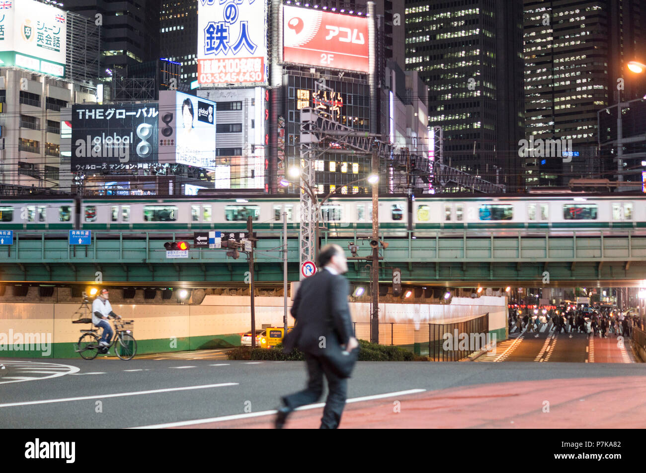 A businessman in a hurry in the rush hour traffic - Stock Image