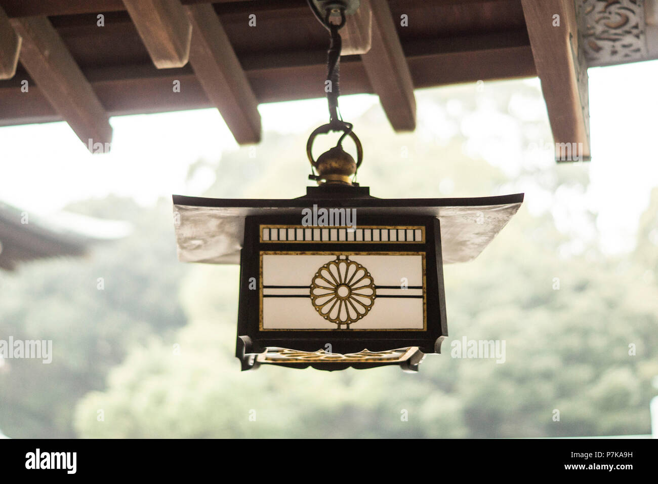 A hanging oil lamp in a temple complex in Tokyo - Stock Image