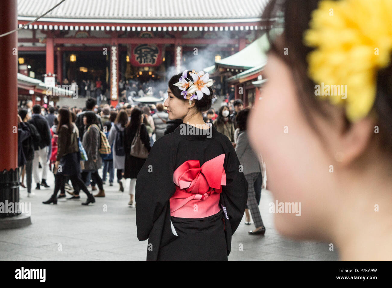 A young lady in a traditional robe in a temple in Tokyo - Stock Image