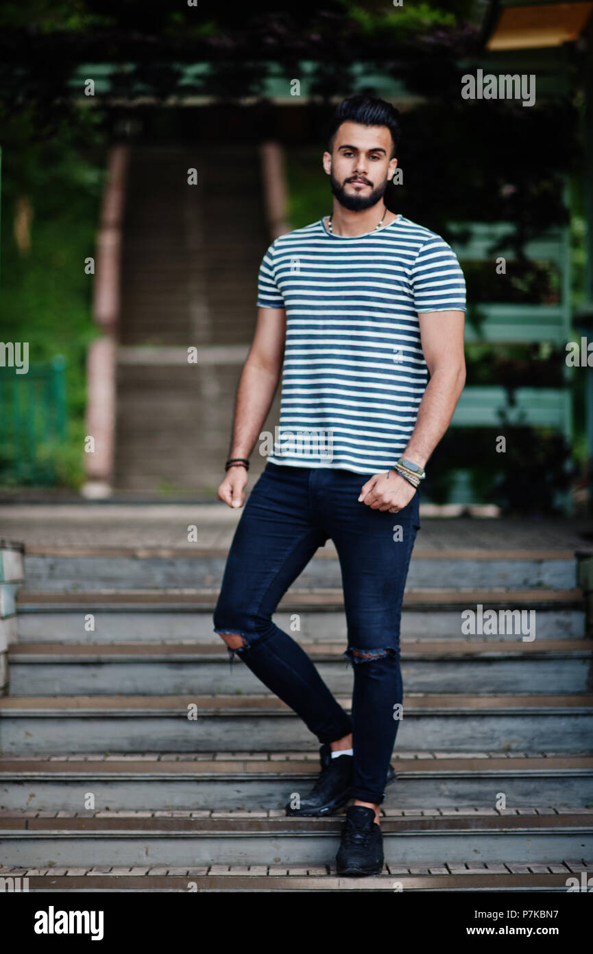 Handsome tall arabian beard man model at stripped shirt