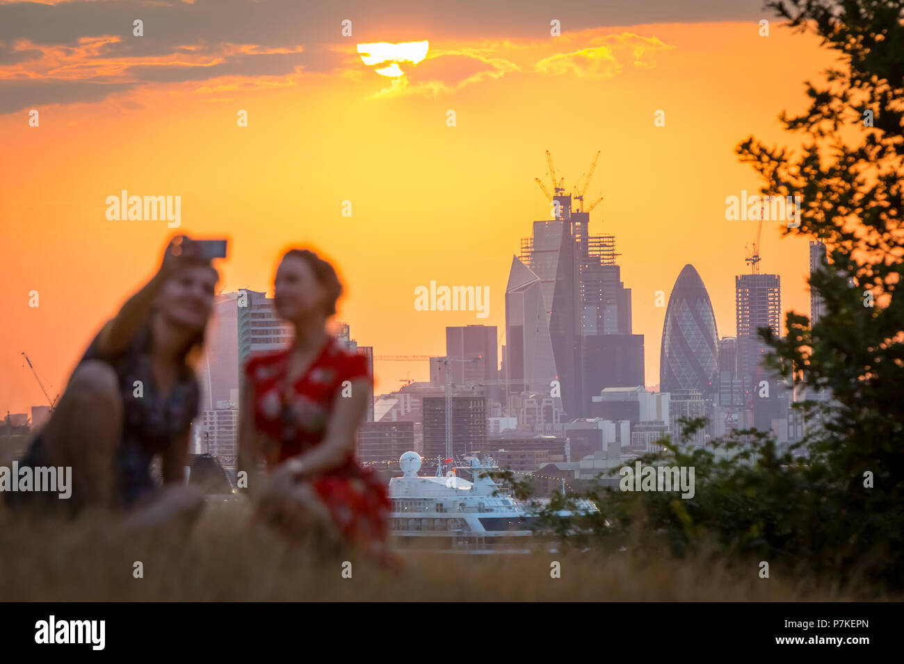 London, UK. 7th July, 2018. UK Weather: Sunset from the top of Greenwich Park ending another summer heatwave day reaching highs of 28C in the city. Credit: Guy Corbishley/Alamy Live News Stock Photo