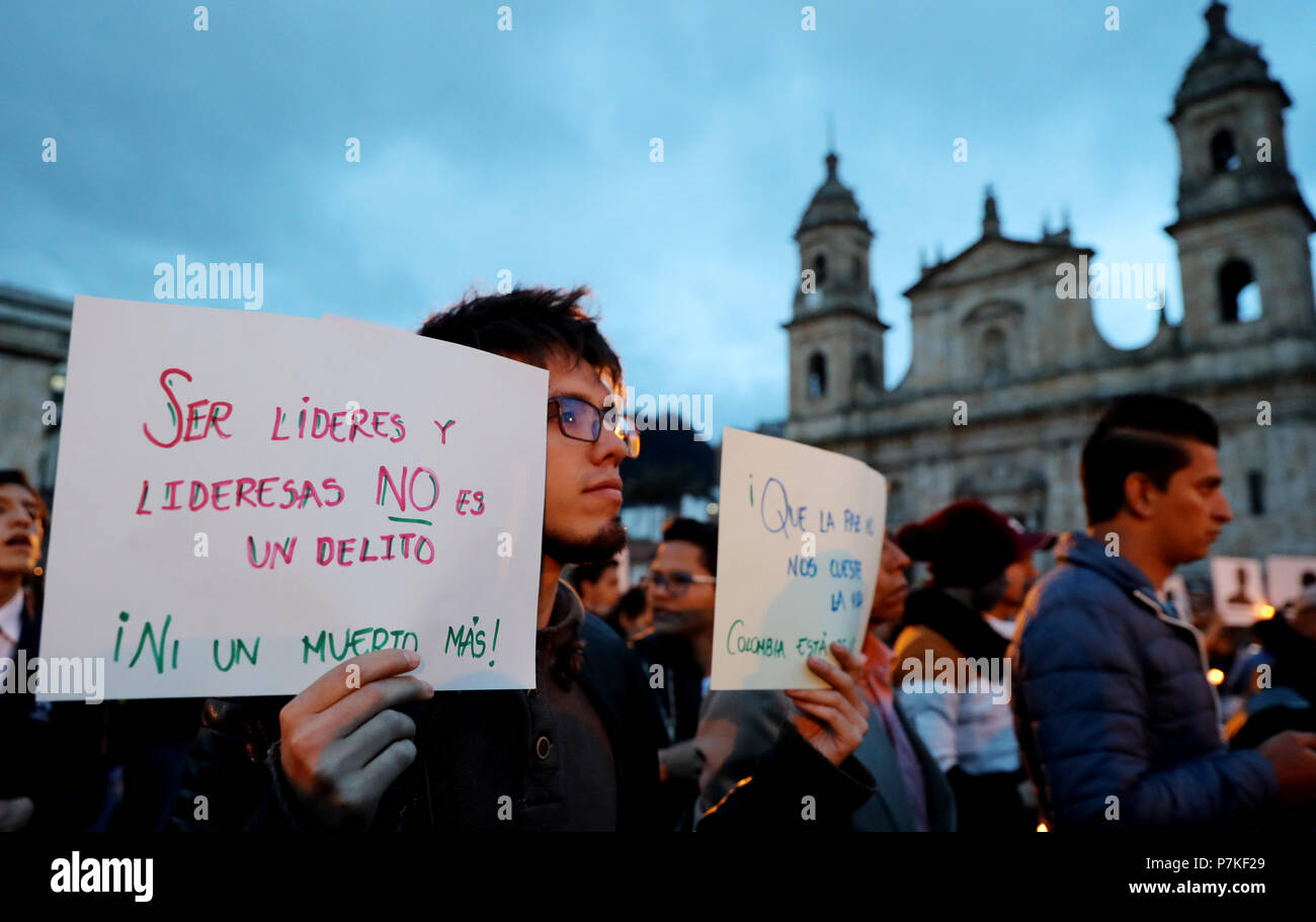 Medellin, Colombia. 07th July, 2018. Hundreds of people participate in an act as a protest against the killing of social leaders in Bogota, Colombia, 06 July 2018. The Attorney General of Colombia today attributed the murder of social leaders and human rights defenders in the country to 'criminal organizations that are real armies at the service of drug trafficking'. A new wave of violence against human rights defenders has alarmed the country in the last week, in which there have been at least five murders of these leaders. EFE/LEONARDO MUÑOZ Credit: EFE News Agency/Alamy Live News - Stock Image
