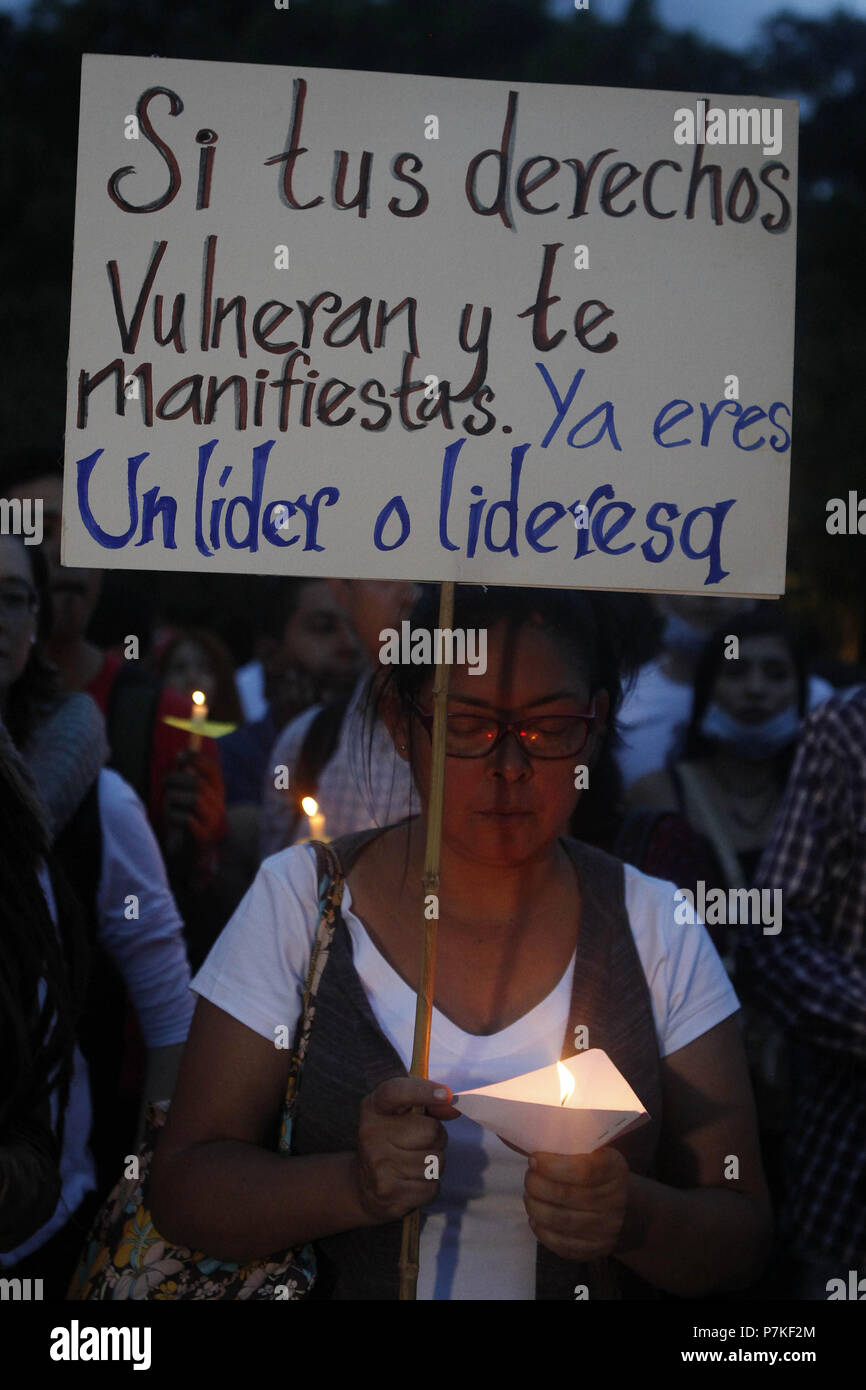 Medellin, Colombia. 07th July, 2018. Hundreds of people participate in an act as a protest against the killing of social leaders in Medellin, Colombia, 06 July 2018. The Attorney General of Colombia today attributed the murder of social leaders and human rights defenders in the country to 'criminal organizations that are real armies at the service of drug trafficking'. Credit: EFE News Agency/Alamy Live News - Stock Image