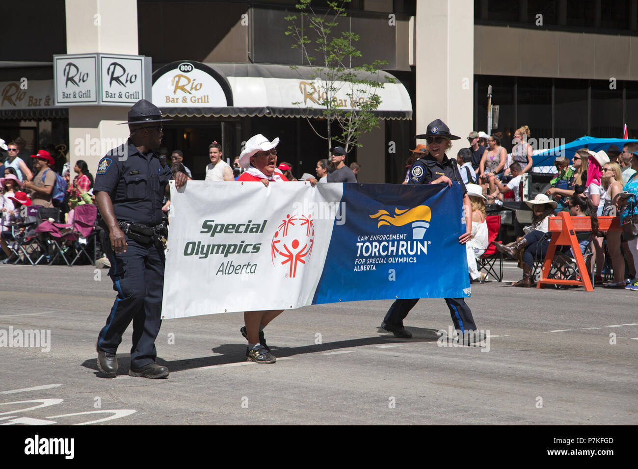 Calgary, Canada. 6th July, 2018.  Law enforcement officers marching for the Torch Run for Special Olympics Alberta in the Calgary Stampede Parade. The parade through downtown kicks off the Calgary Stampede each year. Rosanne Tackaberry/Alamy Live News - Stock Image