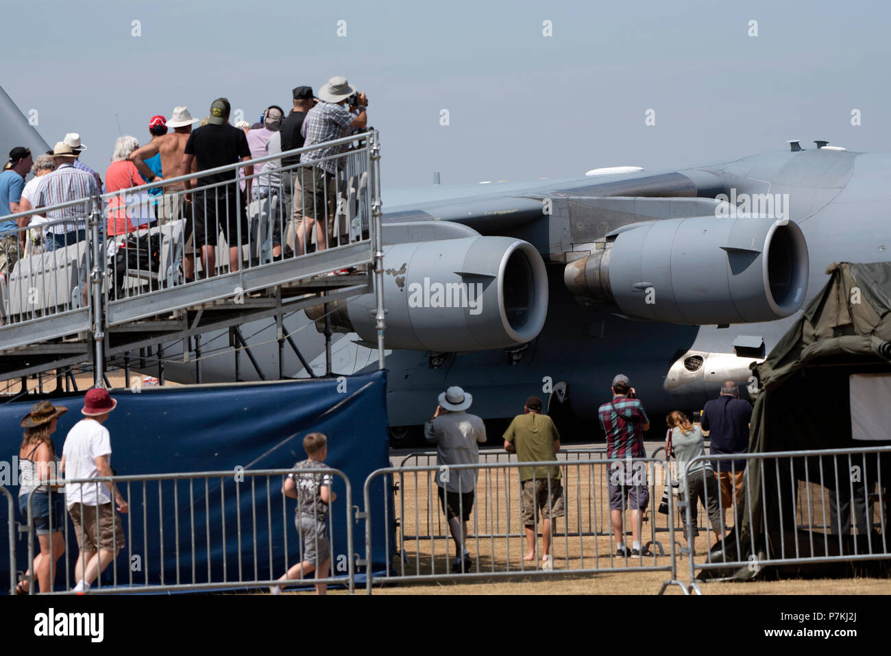 Yeovilton Royal Naval Air Station, Somerset, UK.  Spectators watch the arrival of a C17 Globemaster jet of the US Air Force. - Stock Image