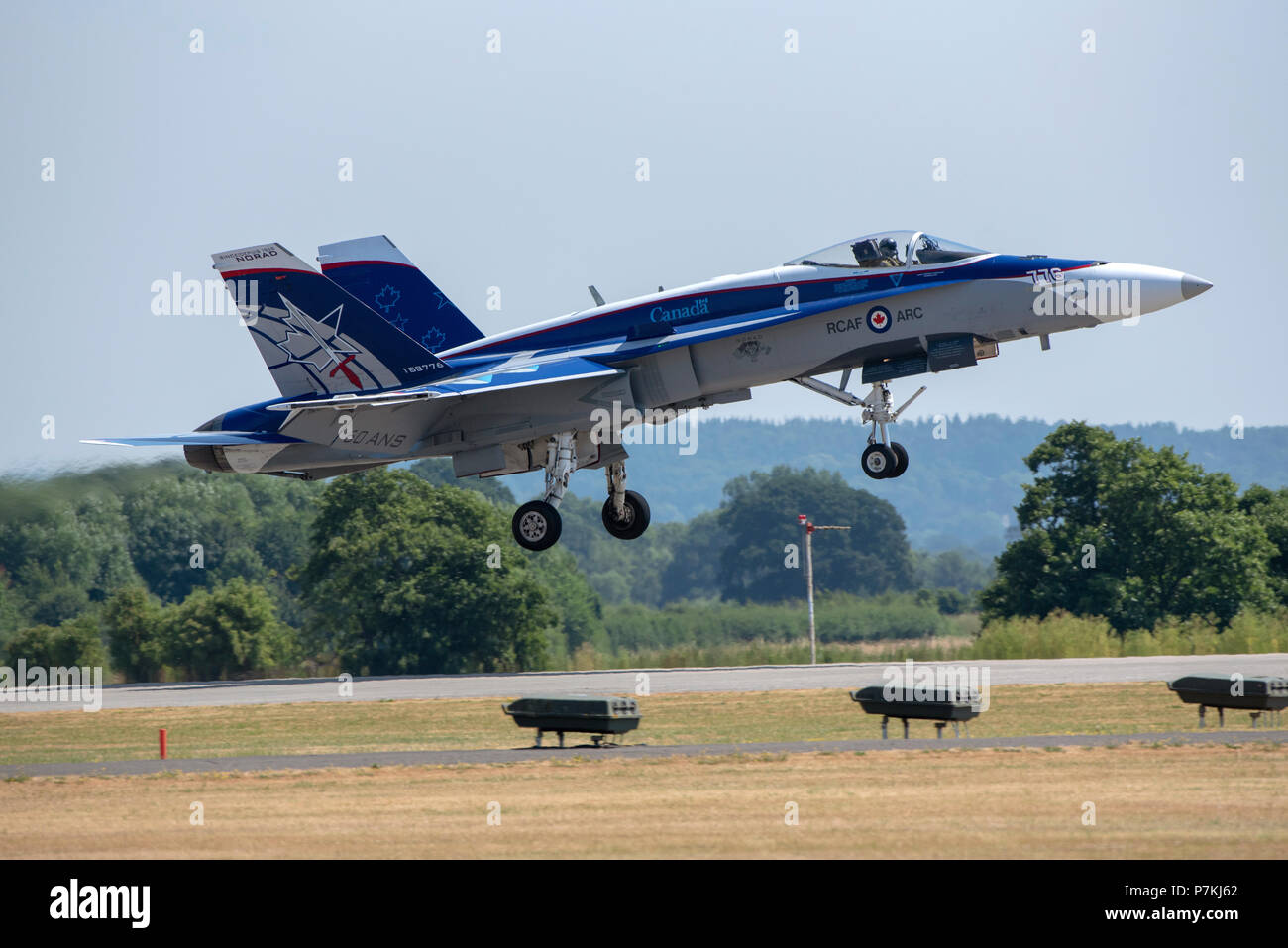 Yeovilton Royal Naval Air Station, Somerset, UK.. A Canadian Air Force twin tailed fighter jet, CF-18 Hornet landing. - Stock Image