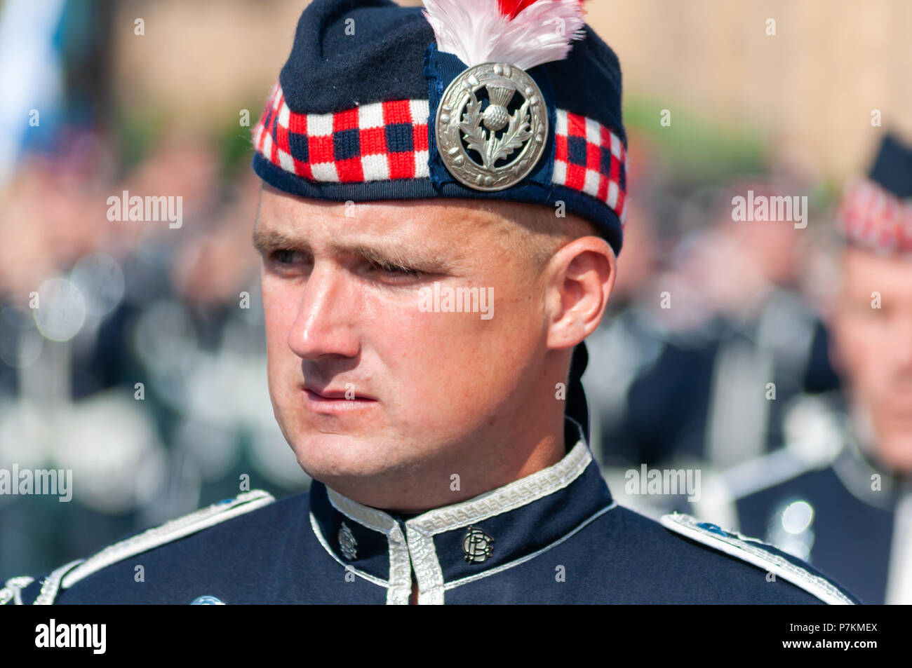 Glasgow, Scotland, UK. 7th July, 2018. A male band member wearing a uniform taking part in the annual Orange Walk through the streets of the city to mark the victory of Prince William of Orange over King James II at the Battle of the Boyne in 1690. Credit: Skully/Alamy Live News Stock Photo