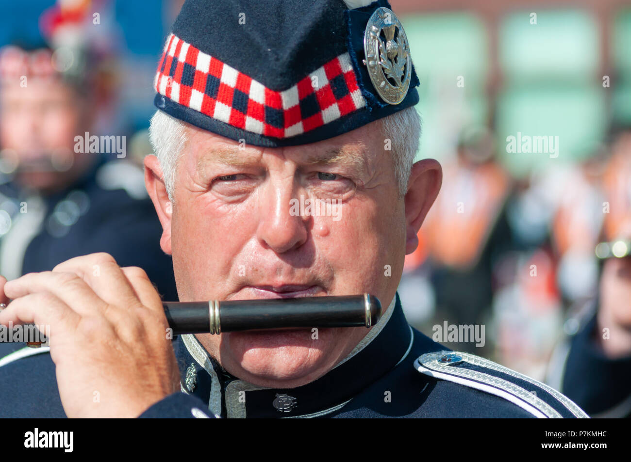 Glasgow, Scotland, UK. 7th July, 2018. A male band member wearing a uniform and playing the flute in the annual Orange Walk through the streets of the city to mark the victory of Prince William of Orange over King James II at the Battle of the Boyne in 1690. Credit: Skully/Alamy Live News - Stock Image