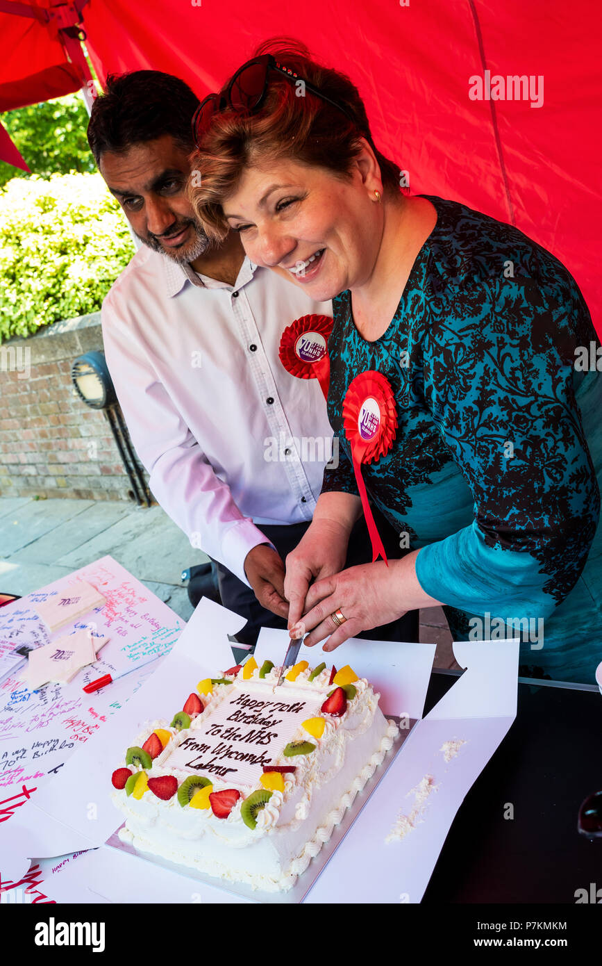 High Wycombe, UK. 7th July 2018. Emily Thornberry, Labour Shadow Secretary of State for Foreign and Commonwealth Affairs, visited High Wycombe as part of Labours NHS 70 year birthday celebration. Emily and members of the public signed a large birthday and get well card. Emily also cut an NHS birthday cake that was eaten by NHS supporters. Credit: Stephen Bell/Alamy Live News. - Stock Image