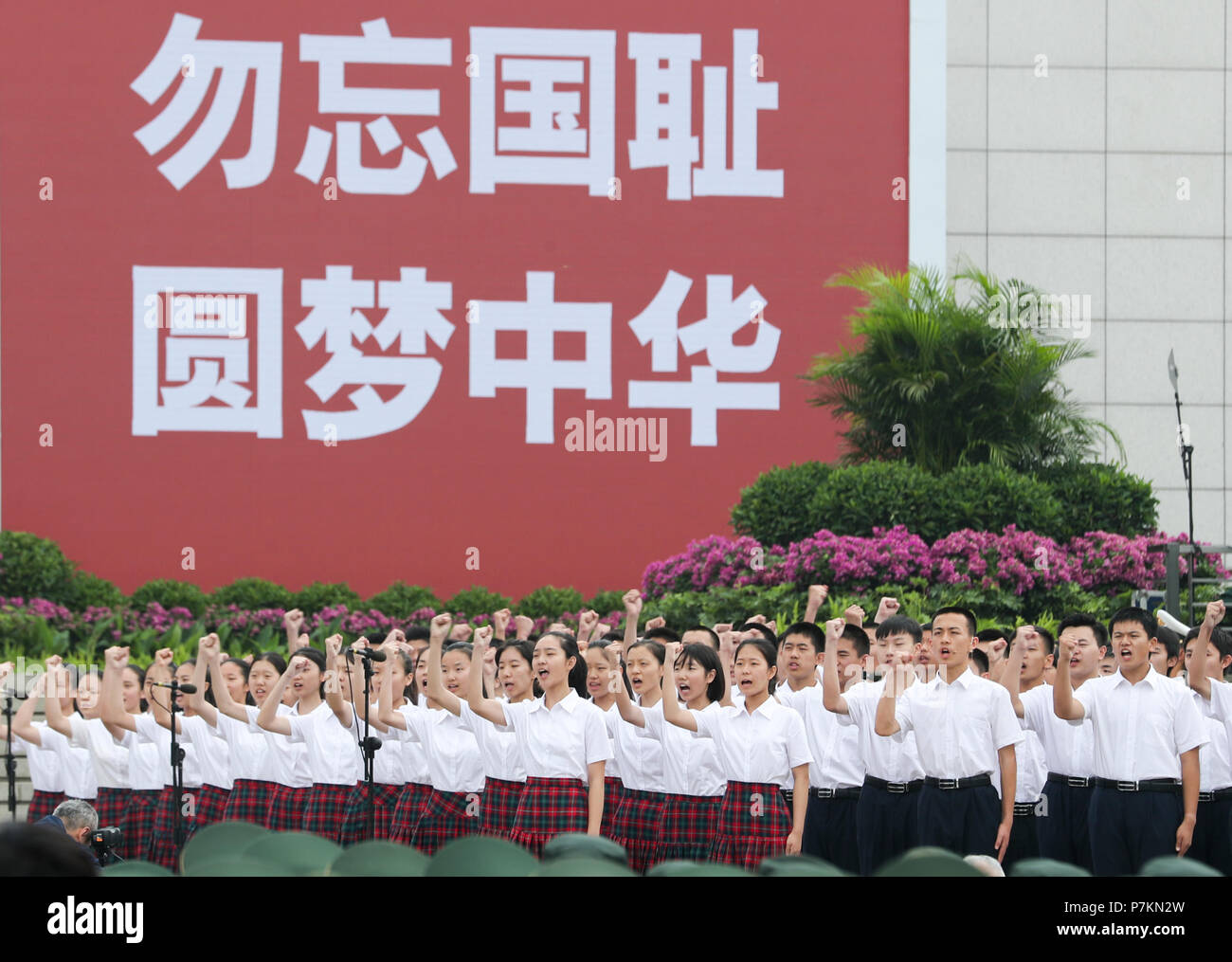 Beijing, China. 7th July, 2018. Students recite letters written by wartime heroes during a ceremony held to commemorate the 81st anniversary of the start of China's comprehensive defense against the Japanese invasion at the Museum of the Chinese People's War of Resistance against Japanese Aggression in Beijing, capital of China, July 7, 2018. Credit: Xie Huanchi/Xinhua/Alamy Live News - Stock Image